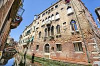 Very old building wil mullioned windows. Venezia. Veneto. Italy.