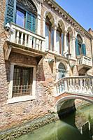 "The so called """"Ponte del Purgatorio"""", an historical single-arch bridge across Rio dell'Arsenale, in Castello Sestiere. The old building it was once ..."
