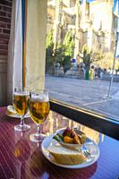 Two glasses of beer and tapa in a cafeteria. Segovia, Spain.