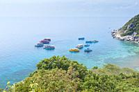Snorkeling, diving and touring boats at Koh Nang Yuan, near Koh Tao, Thailand.