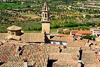 View of the belfry and church of Santa Maria la Mayor in Peñarroya de Tastavins, Teruel, Aragon, Spain