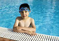 Child in swiming pool. Blue glasses.