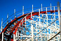 The red and white wooden tracks of the Giant Dipper roller coaster in Santa Cruz, California.