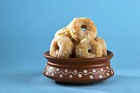 Indian Traditional Sweet Food Balushahi on a blue background.