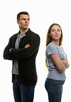 Woman and a man in a grudge look past each other.