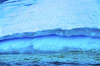 Floating Blue Iceberg Floating Sea Water Charlotte Bay Antarctic Peninsula Antarctica. Glacier ice blue because air squeezed out of snow.