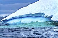 Floating Blue Iceberg Glaciers Mountains Sea Water Charlotte Bay Antarctic Peninsula Antarctica. Glacier ice blue because air squeezed out of snow.