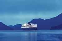 The M/V Kennicott sailing out of the Sitka Terminal. Sitka, Alaska, USA. The Alaska Marine Highway System operates along the south-central coast of th...