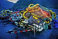 Piled up seiner fishing nets on trailers parked outside Silver Bay Seafood, Gary Paxton Industrial Park near Sitka, Alaska, USA.