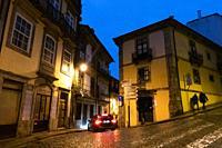 Rainy night in a street in Porto, Portugal.