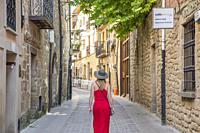 Tourist woman walking down street in Laguardia Rioja alavesa wine route. Alava. Basque country. Spain.