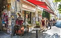 """street scene in front of bookstore """"""""zur schwebenden weltkugel"""""""", kastanienallee, berlin, germnay."""