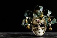venetian carnival mask on black background.