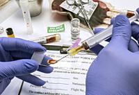 Scientific examines sample of coronavirus.