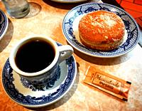 A coffee cup and a sweet bread in Sanborns Restaurant in Coyoacan, Mexico