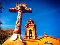 A Cruz Florida (flowery cross) decorates the entrance of the San Sebastian church in San Sebastian Bernal, Queretaro State, Mexico