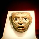 A mask of a human person decorates Templo Mayor museum im Mexico City, Mexico