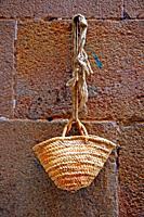 basket hanging on the wall, Ciutat Vella, Barcelona, ??Catalonia, Spain