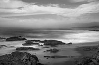 Waves crash along the coastline near San Simeon, California.