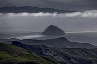 Moro Rock stands out amongst the fog enveloping Moro Bay, California.