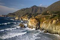 Waves crash along the rocky coastline south of Big Sur, California.