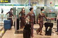 Singapore, Republic of Singapore, Asia - Upon their arrival at Changi Airport, Singapore Airlines flight attendants wear protective masks to prevent a...