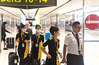 Singapore, Republic of Singapore, Asia - Upon their arrival at Changi Airport, Scoot Airways flight attendants wear protective masks to prevent an inf...