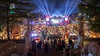 Jinghong, China - December 30, 2019: Gaozhuang Night Market at night with tourist walking by.