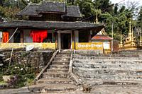 Xishuangbanna, China - December 31, 2019: Dai temple in the countryside of Xishuangbanna. Foreing text saying: Buddhist temple.