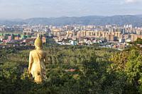 Jinghong, China - January 2, 2020: Panoramic view of jinghong from Mengle Temple with Giant Buddha in Xishuangbanna - Yunnan.