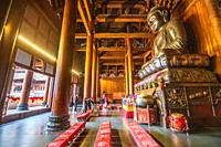 The Buddha statue in the main hall of the Jing'an Temple , Shanghai, China.