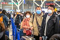 Shanghai, China, 28th Jan 2020, People standing in line at the airport wear medical masks to prevent contracting the Coronavirus, Edwin Remsberg.