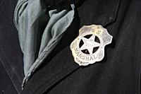 Close up of a US Marshal tin star proudly displayed by reenactor at an event in Tucson AZ.
