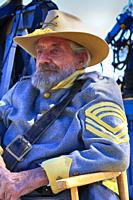 Reenactor wearing the uniform of a Sargeant in the Confederate Army at an event in Tucson AZ.