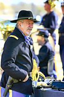 Renactor dressed in a uniform of the 1880s US Army Officer in the 5th Cavalry at Fort Lowell, Tucson AZ.