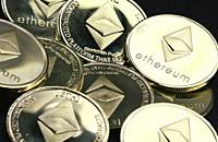 Silver ethereum coins. cryptocurrency, Ethereum was proposed in late 2013 by Vitalik Buterin, a cryptocurrency researcher and programmer. Development ...