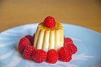 Creme caramel with raspberries.