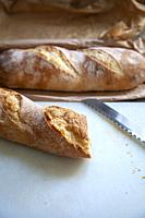 Baguette Bread on Breadboard.