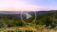 panorama view of a sunset behind mountain crests of the Black Forest as time lapse, Germany, panorama from a high mountain at Kaltenbronn, wide view a...