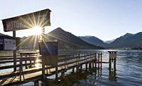 Sunrise at lake and village Schliersee in the bavarian Alps during autumn. Europe, Central Europe, Bavaria, Germany.