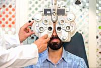 Patient in modern ophthalmology clinic checking the eye vision .