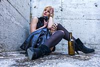 Abandoned young woman drinker
