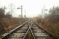 Moody scenic of railroad tracks (railroad switch) in the fog - Penrose (near Brevard), North Carolina, USA.