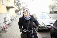 Woman on bicycle, Munich, Germany