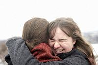 couple hugging in winter
