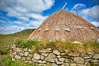 Reconstructed Iron Age House, Bostadh, Great Bernera, Isle of Lewis, Outer Hebrides, Scotland. A 1993 storm revealed stonework thought to belong to fo...
