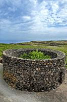 Pantelleria, Trapani province, Sicily, Italy, Europe, in the foreground typical pantesco garden construction built to protect plants from strong winds...