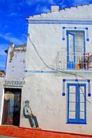 Graffiti on the facade, Calella de Palafrugell, Costa Brava, Catalonia, Spain