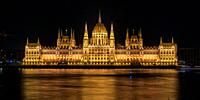 Night shot of the Danube River and the Parliament of Budapest in Hungary.