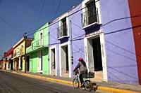 Cyclist in front of the colonial buildings in the city center, Cholula, Puebla State, Mexico, Central America
